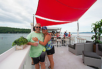 Tony and Dawn Cava topside at the Dive Bar in Small Cove, Lake Winnipesaukee Thursday evening.  (Karen Bobotas/for the Laconia Daily Sun)