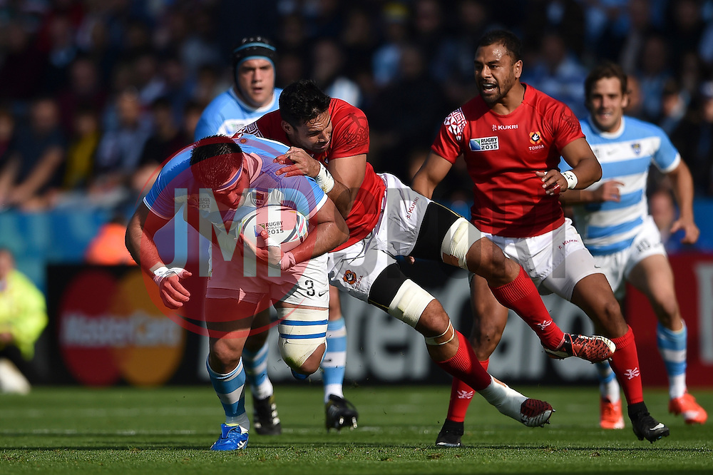 Ramiro Herrera of Argentina is tackled in possession - Mandatory byline: Patrick Khachfe/JMP - 07966 386802 - 04/10/2015 - RUGBY UNION - Leicester City Stadium - Leicester, England - Argentina v Tonga - Rugby World Cup 2015 Pool C.