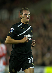 STOKE-ON-TRENT, ENGLAND - Monday, October 31, 2011: Newcastle United's Steven Taylor wearing a face mask to protect a broken nose during the Premiership match against Stoke City at the Britannia Stadium. (Pic by David Rawcliffe/Propaganda)
