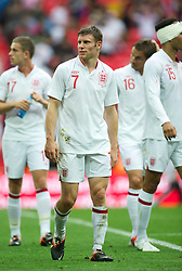 LONDON, ENGLAND - Saturday, June 2, 2012: England's James Milner applauds the supporters after the 1-0 victory over Belgium during the International Friendly match at Wembley. (Pic by David Rawcliffe/Propaganda)