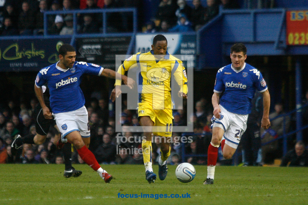 Portsmouth - Saturday January 22nd 2011: Leeds' Sanchez Watt is chased by Portsmouth's Hayden Mullins and Joel Ward during the Npower Championship match at Fratton Park, Portsmouth. (Pic by Daniel Chesterton/Focus Images)