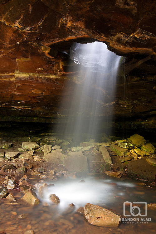 This geological phenomenon in northern Arkansas was created by a flowing stream that over time created a large hole that flows into a cave below named the Glory Hole.