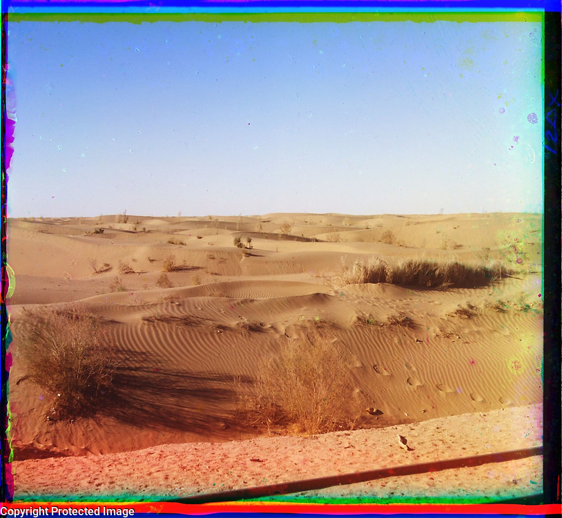 1905<br /> This photograph shows an expanse of sand dunes in the region between Bayramaly (present-day Turkmenistan) and Chardjuy. The Russian settlement of Chardjuy (present-day Turkmenabat) was founded in 1886 near the site of an ancient town of the same name. Located on the Amu-Darya (Oxus) River, the town had become an important railroad junction by the time this photograph was taken. Visible in the lower-right corner is a section of rail on the track. The image is by Russian photographer Sergei Mikhailovich Prokudin-Gorskii (1863&ndash;1944), who used a special color photography process to create a visual record of the Russian Empire in the early 20th century. Some of Prokudin-Gorskii&rsquo;s photographs date from about 1905, but the bulk of his work is from between 1909 and 1915, when, with the support of Tsar Nicholas II and the Ministry of Transportation, he undertook extended trips through many different parts of the empire. Prokudin-Gorskii was particularly interested in recently acquired territories of the Russian Empire such as Turkestan (present-day Uzbekistan and neighboring states), which he visited on a number of occasions, including two trips in 1911. Turkestan appealed to him as a showcase for the transformation brought by Russian settlement, particularly in agriculture. Economic development of Turkestan was closely related to the construction of railroads, such as the Trans-Caspian, begun in 1879 and expanded over the next three decades.