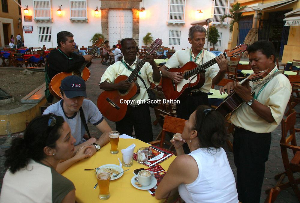 "Musicians play for visitors in the Plaza Santo Domingo, a poplar spot in the ""Old City"" in Cartagena, a unique travel destination on Colombia's Caribbean coast. (Photo/Scott Dalton)"