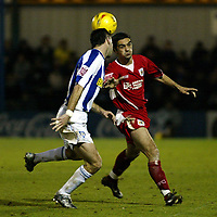 Photo: Chris Ratcliffe.<br />Colchester United v Bristol City. Coca Cola League 1. 17/01/2006.<br />Scott Murray (R) of Bristol City attacks Colchester.
