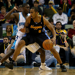 Dec 18, 2009; New Orleans, LA, USA;  Denver Nuggets guard Arron Afflalo (6) is guarded by New Orleans Hornets guard Darren Collison (2) during the first half at the New Orleans Arena. Mandatory Credit: Derick E. Hingle-US PRESSWIRE