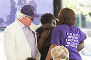 Andy Savage, left, Jarell Smalls, center, and Felicia Sanders embrace during a memorial service for the victims of the Mother Emanuel African Methodist Episcopal Church shooting on the 2nd anniversary June 17, 2017 in Charleston, South Carolina. Nine members of the historic African-American church were gunned down by a white supremacist during bible study on June 17, 2015.