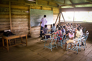 Students get a Spanish lesson at a school in the remote village of Krin Krin, Nicaragua. The majority of residents on the Rio Coco speak indigenous languages, such as Miskito, and little or no Spanish, further isolating them from the rest of the country. This is a private school developed by a pastor from Puerto Cabezas to empower the children by receiving a better education.