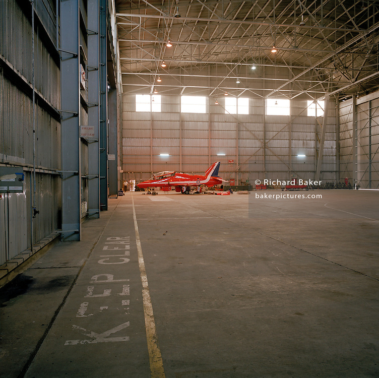 A grounded Hawk jet in a hangar used by the Red Arrows, Britain's RAF aerobatic team.