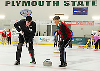 Will Brown and Joan Magrauth on the Madison Bowlers team sweep their stone during Curling League play Thursday evening at the Plymouth State University Ice Arena.  (Karen Bobotas/for the Laconia Daily Sun)