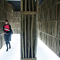 London, UK - 21 January 2014: a woman walks inside the  installation by Li Xiaodong at the Sensing Spaces: Architecture Reimagined exhibition at the Royal Academy of Arts