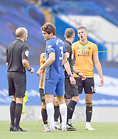 Football - 2019 / 2020 Premier League - Chelsea vs. Wolverhampton Wanderers<br /> <br /> Wolverhampton Wanderers' Conor Coady (right) speaks to Referee Stuart Attwell after their 2-0 defeat, at Stamford Bridge.<br /> <br /> COLORSPORT/ASHLEY WESTERN