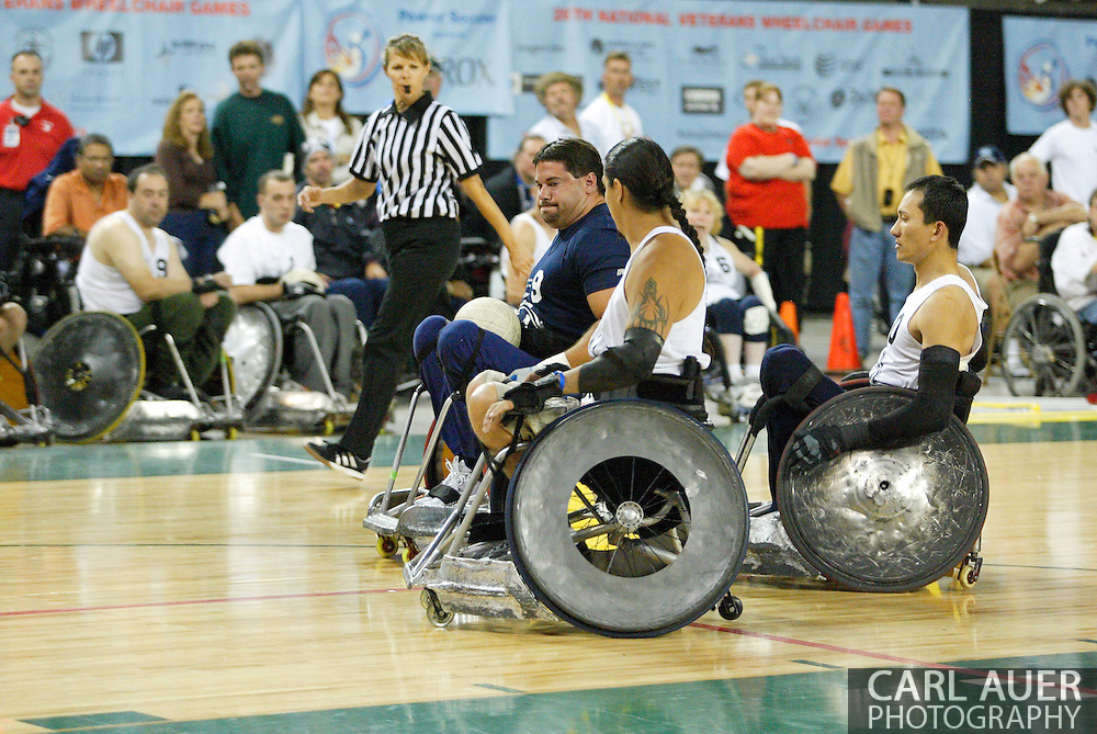 July 7th, 2006: Anchorage, AK - Blue team power scorer, Scot Severn (9), looks for a opening to score as White went on to defeat Blue in the gold medal game of Quad Rugby at the 26th National Veterans Wheelchair Games.