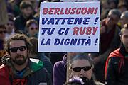 "A man carries a placard that reads ""Berlusconi you leave! You steal our dignity!"" (Tu Ruby la nostra dignità! the sentece puns with the meaning of the name Ruby, that means also steal ""rubi"") at a rally organized by il Popolo viola (The Purple People, political movement) against Prime Minister Berlusconi in Arcore, February 6, 2011. Berlusconi is accused to have had a sexual relation when Ruby was under-age. © Carlo Cerchioli..Un uomo con un cartello che dice ""Berlusconi vattene! Tu Ruby la nostra dignità"" alla manifestazione organizzata da Il popolo viola contro Berlusconi ad Arcore, 6 febbraio 2011. Berlusconi è accusato di aver avuto rapporti sessuali con Ruby quando lei era minorenne."
