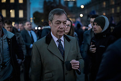© Licensed to London News Pictures. 15/01/2019. London, UK. Former UKIP leader Nigel Farage (centre) on College Green as MPs continue to debate Prime Minister Theresa May's proposed Brexit deal. Parliament will vote on the deal this evening. Photo credit: Rob Pinney/LNP