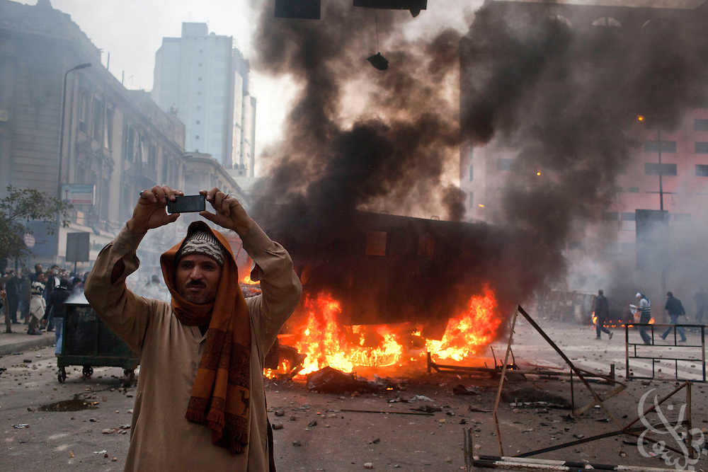 An Egyptian man shoots video with his phone on Ramsis street during massive and unprecedented demonstrations January 28, 2011 across Cairo, Egypt . The protests, inspired by the recent revolution in Tunisia, have struck a chord with Egypt's population, tired of inflation, high unemployment and alleged corruption within the Mubarak government..Slug: Egypt.Credit: Scott Nelson for the New York Times