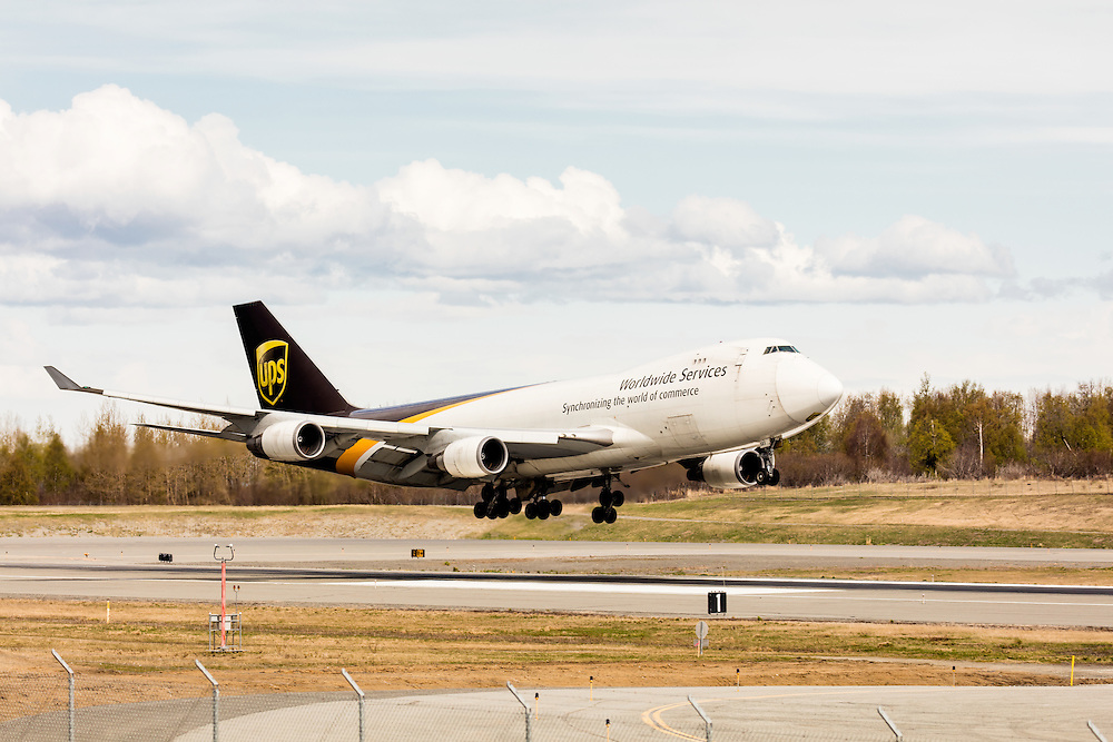 UPS cargo jet landing at Ted Stevens Anchorage International Airport in Southcentral Alaska. Spring. Afternoon.