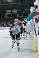 KELOWNA, CANADA - JANAURY 4: Carter Rigby #11 of the Kelowna Rockets celebrates a goal against the Vancouver Giants on January 4, 2014 at Prospera Place in Kelowna, British Columbia, Canada.   (Photo by Marissa Baecker/Shoot the Breeze)  ***  Local Caption  ***