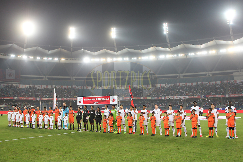 Teams line up for the national anthem during match 16 of the Hero Indian Super League between The Delhi Dynamos FC and NorthEast United FC held at the Jawaharlal Nehru Stadium, Delhi, India on the 29th October 2014.<br /> <br /> Photo by:  Ron Gaunt/ ISL/ SPORTZPICS