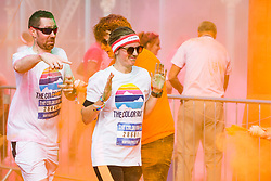 """© Licensed to London News Pictures. 23/09/2017. Brighton, UK. Thousands of participants run in the Brighton """"Color Run"""" event. Runners get covered in coloured powder after each kilometre on the 5 kilometre course. Photo credit: Hugo Michiels/LNP"""