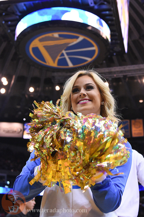January 2, 2015; Oakland, CA, USA; Golden State Warriors Dance Team dancer Tarah Naismith performs before the game against the Toronto Raptors at Oracle Arena. The Warriors defeated the Raptors 126-105.
