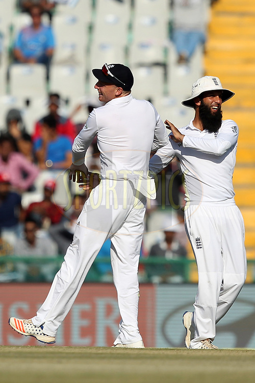 Jos Buttler and Moeen Ali of England celebrates wicket of Karun Nair of India during day 2 of the third test match between India and England held at the Punjab Cricket Association IS Bindra Stadium, Mohali on the 27th November 2016.Photo by: Prashant Bhoot/ BCCI/ SPORTZPICS