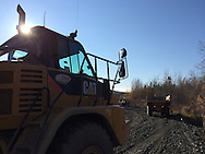 Cruz Construction rock trucks haul material on Tofty Road just outside of Manley Hot Springs, Alaska, in September 2014.