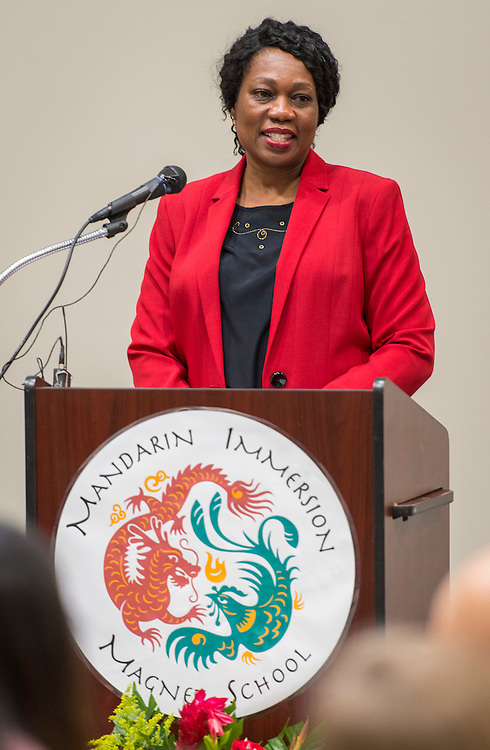 Dr. Esther Omogbehin comments during the dedication and ribbon cutting for the Mandarin Immersion Magnet School, October 24, 2016.