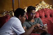Ahmed Mohamed plays a video game with a friend at his home in Irving, Texas on July 15, 2016. (Cooper Neill for The Washington Post)