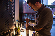 New York, NY, Sept. 30, 2013. Grant Reynolds, wine director at Charlie Bird, opening a botle of Montevetrano Agliancio, 2011.
