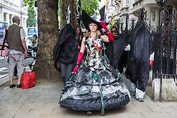 London, UK. 2 July, 2019. Climate change activists from Extinction Rebellion Art and Culture take part in a silent procession to visit the offices of five major oil companies - ENI, CNPC, Saudi Aramco, Repsol and BP - in order to declare them as crime scenes.