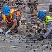 Blue collar worker repairing and replace cobblestones on city street after underground repairs.<br /> <br /> Cobblestone is a natural building material based on cobble-sized stones, and is used for pavement roads, streets, and buildings. Cobblestones were largely replaced by quarried granite setts.  Setts were relatively even and roughly rectangular stones that were laid in regular patterns. <br /> <br /> There are not many of the older such streets left because theyhave been paved over with asphalt.