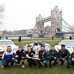 The Aston Martin, Strakka LMP1 and the RAM Racing Ferrari with Stephane Sarrazin, Darren Turner, Jonny Kane, Nick Leventis, John Martin and Alex Brundle holding the Championship trophy with Danny Watts, at the FIA-WEC series launch situated in Potters Fields overlooking Tower Bridge, London on the 22nd March 2013. WAYNE NEAL | STOCKPIX.EU
