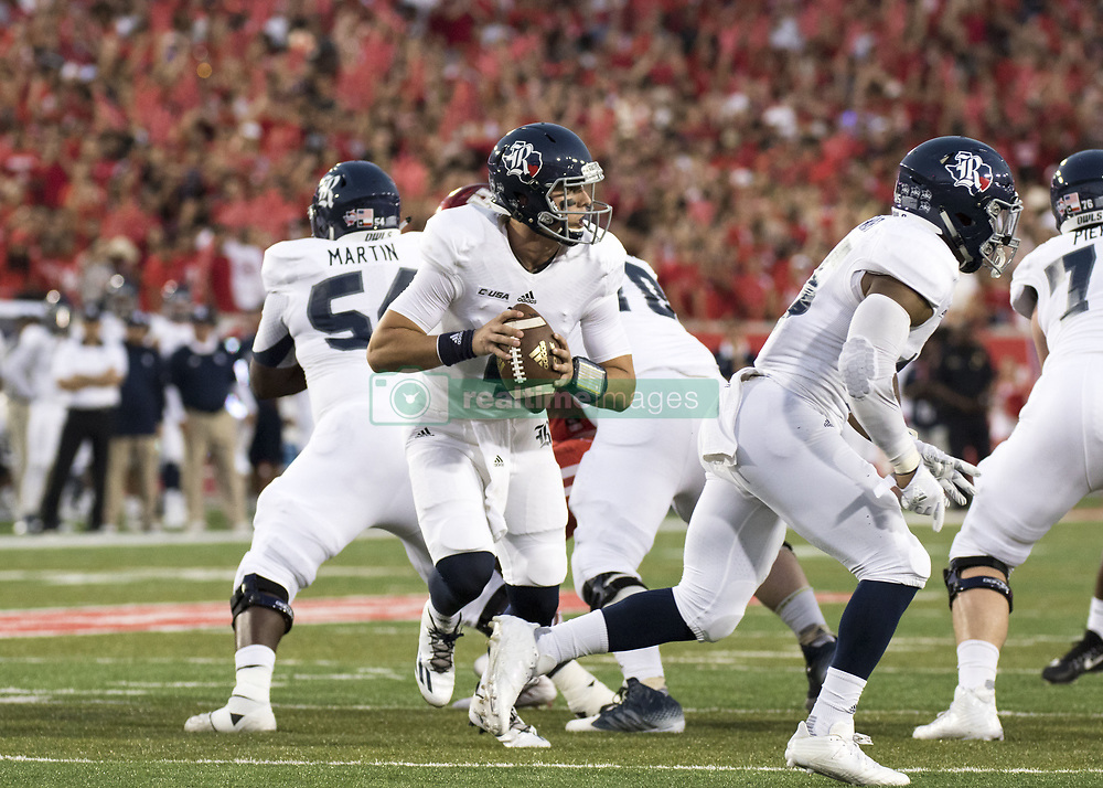 September 16, 2017 - Houston, TX, USA - Rice Owls quarterback Sam Glaesmann (4) drops back to pass during the first quarter of the college football game between the Houston Cougars and the Rice Owls at TDECU Stadium in Houston, Texas. (Credit Image: © Scott W. Coleman via ZUMA Wire)