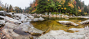 Enjoy a short walk along the Swift River in Rocky Gorge Scenic Area on Kancamagus Highway (NH Route 112), in White Mountain National Forest, New Hampshire, USA. The White Mountains (a range in the northern Appalachian Mountains) cover a quarter of the state of New Hampshire. Leaf peepers love the peak of autumn foliage around the first week of October. The panorama was stitched from 9 overlapping photos.
