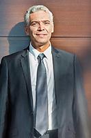 Portrait of Smiling mature businessman standing in suit