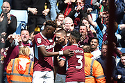 Aston Villa midfielder Conor Hourihane (14) scores a goal and celebrates  1-1 with Aston Villa striker(on loan from Chelsea) Tammy Abraham (18) and Aston Villa defender Neil Taylor (3) during the EFL Sky Bet Championship first leg Play Off match between Aston Villa and West Bromwich Albion at Villa Park, Birmingham, England on 11 May 2019.
