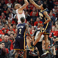 16 April 2011: Chicago Bulls power forward Carlos Boozer (5) takes a jumpshot over Indiana Pacers shooting guard Brandon Rush (25) during the Chicago Bulls 104-99 victory over the Indiana Pacers, during the game 1 of the Eastern Conference first round at the United Center, Chicago, Illinois, USA.
