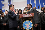 Comedian Stephen Colbert sings the national anthem during a rally with former Republican presidential candidate Herman Cain at the College of Charleston on January 20, 2012 in Charleston, South Carolina. Colbert held the event with Cain, titled Rock Me Like a Herman Cain South Cain-olina Primary Rally, as part of his pseudo-run for president of The United States of South Carolina.