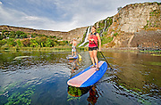 Jessica Florian and Elijah Weber riding the Standup Paddle Board at Thousand Springs in the Snake River Canyon near the city of Hagerman in southern Idaho