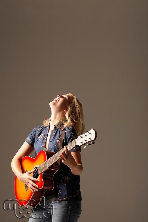 Laughing Woman Playing Guitar