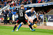 St Johnstone defender Brian Easton (#24) takes on Partick Thistle midfielder Chris Erskine (#10) during the Betfred Scottish Cup match between St Johnstone and Partick Thistle at McDiarmid Stadium, Perth, Scotland on 8 August 2017. Photo by Craig Doyle.