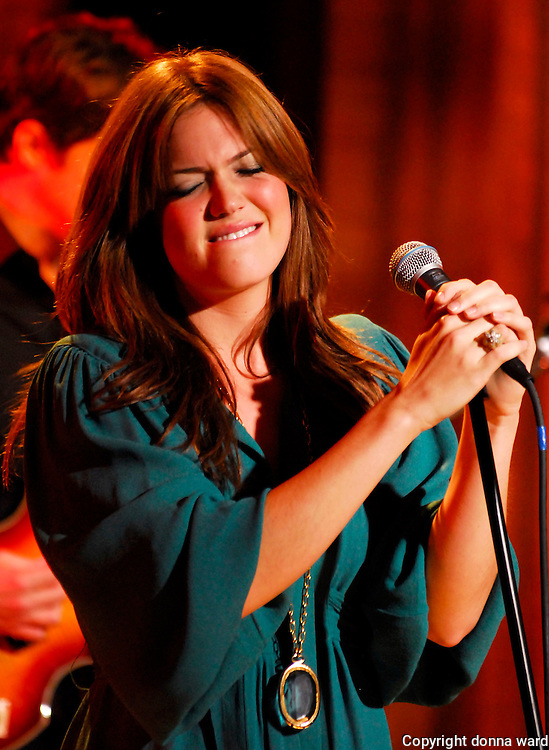 """Mandy Moore performs while taping her """"I Am Mandy Moore"""" Special for Oxygen at Comix in the Meat-packing District on Friday, June 22, 2007 in New York."""