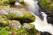 Water cascades over boulders in this Lake District stream - photographed in October.