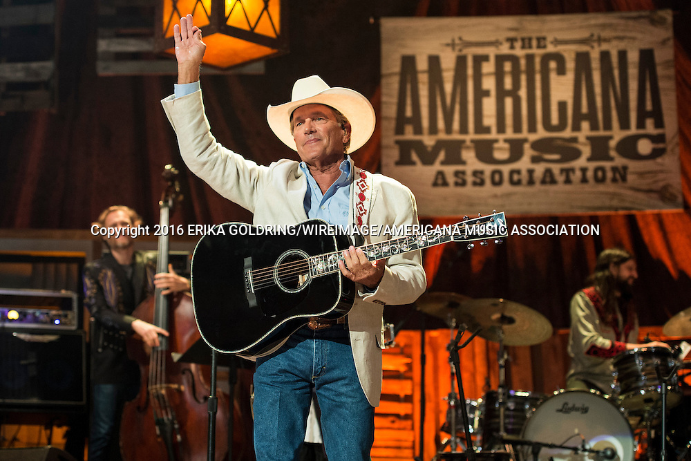 L-R) Chris Wood, George Strait and Fred Eltringham perform at the Ryman Auditorium during the Americana Music Honors and Awards Show on September 21, 2016, in Nashville, TN.