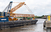 arrival of barge and crane at Convent Marine Terminal in Convent, Louisiana for Sarens