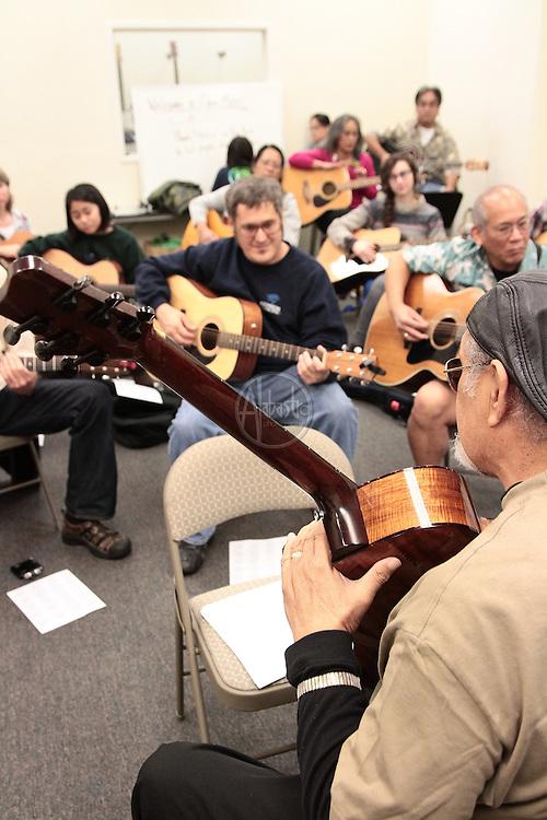 SoCal Slack Key Festival Guitar Workshop with Cyril Pahinui at Opus Music.
