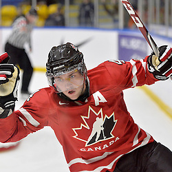 WHITBY, - Dec 16, 2015 -  Game #8 - Czech Republic vs. Canada East at the 2015 World Junior A Challenge at the Iroquois Park Recreation Complex, ON.  Lucas Batt #4 of Team Canada East celebrates the goal during the second period.<br /> (Photo: Shawn Muir / OJHL Images)