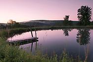 A still pond at sunrise in Alexandra Van Horne's garden in Hauverville, New York State, U.S.A.