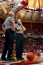 18 January 2009: Ball on the ground waiting for play to resume, Tom Eades and Gerry Pollard discuss an officiating dilemma. The Illinois State University Redbirds top the Missouri State Bears 68-56 on Doug Collins Court inside Redbird Arena on the campus of Illinois State University in Normal Illinois
